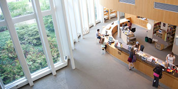 A bird's eye view of the circulation desk in the campus library.