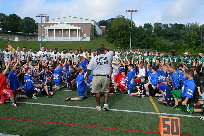 Coach Kevin Loney '99 leads a summer football clinic at Nichols College in Dudley, Mass.