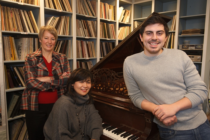 Frederick Schlick poses at the piano with his instructors.
