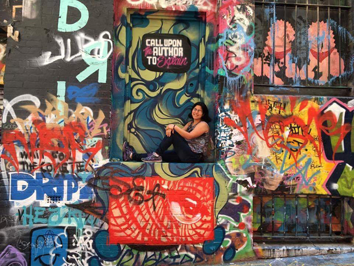 Study-abroad student Nancy Gomez '18, on Hosier Lane, Melbourne, Australia.