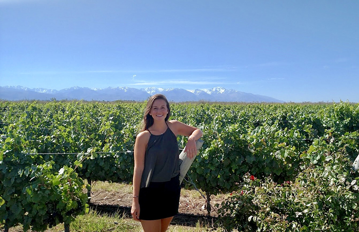 Natalie Cassidy '18 poses in a vineyard in Mendoza, Argentina, where she conducted original research.