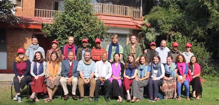 Students and professors in the Nepal Mosaic pose for a group shot with local graduate students during their trip to Nepal.