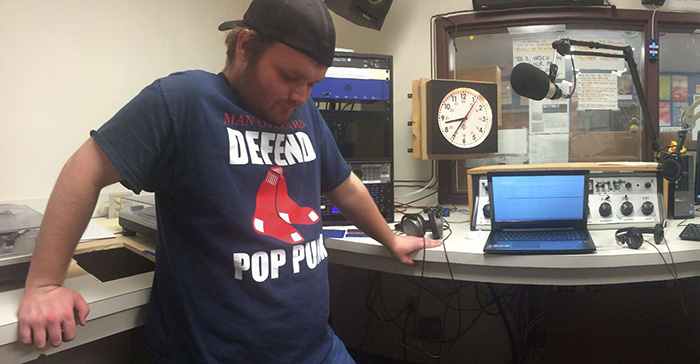 WDCV station manager/DJ Jon Northridge '16 listens to music during his radio show.