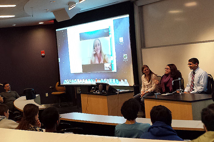 Emily Swain '10 chats about her experiences as a science teacher during a career-discussion event with Allison Hall '11 (seated, far left) and Adnan Solaiman '10 (seated, far right). Katie McCann '11 (onscreen) weighed in on the conversation via Skype.
