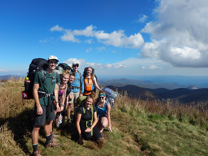 The Outing Club pauses during a hike during the 2014 fall pause.