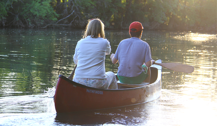 a photo of two students in a boat