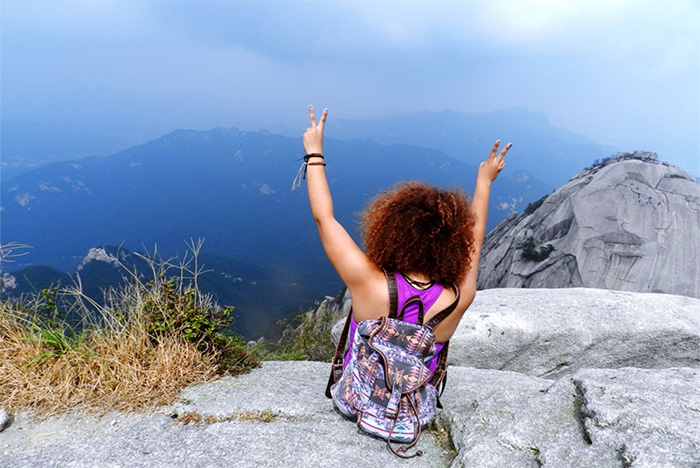 Nicole Price '15, a biochemistry & molecular biology major, at the top of Bukhansan Mountain, Seoul, Korea.