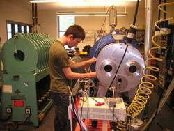 Photograph of Sean Brannon working in the Plasma Lab