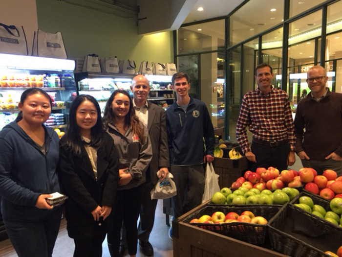 Students in a Fundamentals of Business class taught by Steve Riccio (center) visit with the owners of Provisions grocery store, in Harrisburg, Pa.