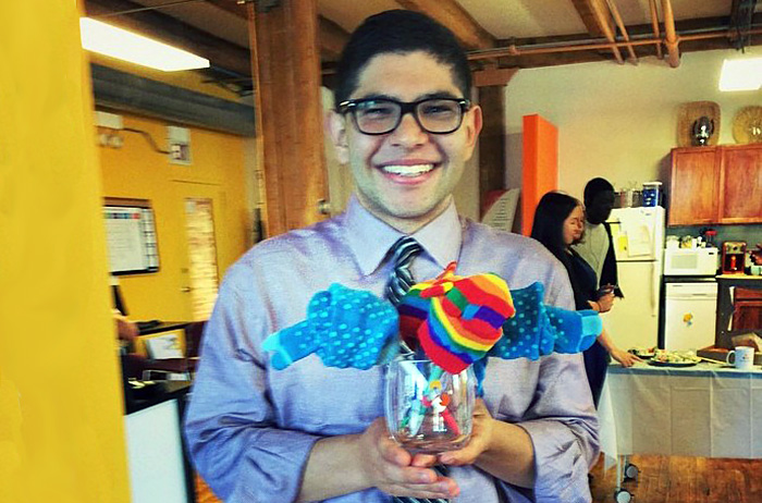 Nick Rejebian '17 poses with a creative goodbye present--a sock bouquet--at the close of his summer internship.