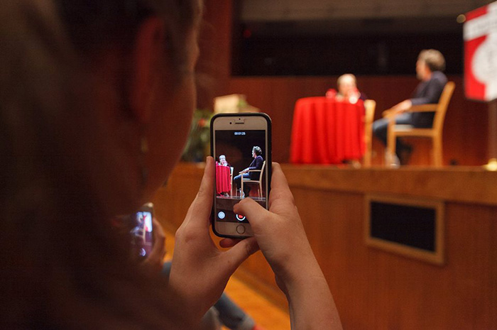 A Dickinson College student snaps a photo of Mark Ruffalo during his public address on campus.