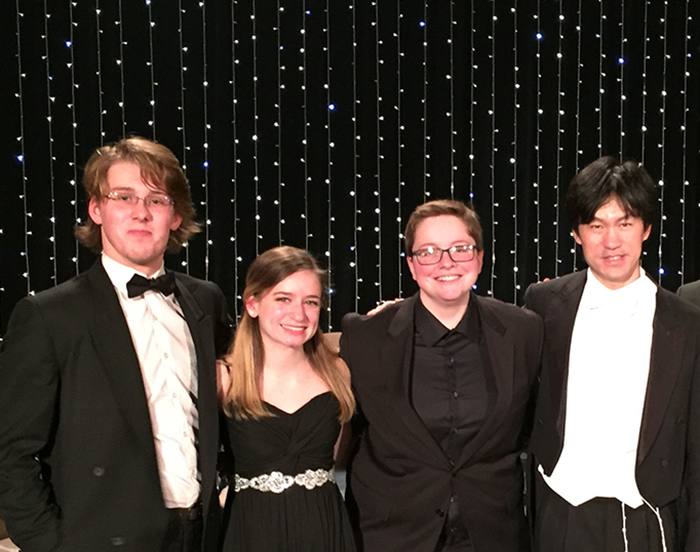 From left: Isaac Ward '18, Anna Ferry '19, Morgan Bates '18 and Cheung Chau, director of Sinfonietta Polonia.