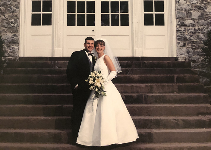 Spyro Karetsos '96 and Laura Otten Karetsos '96, on the steps of Old West on their wedding day.