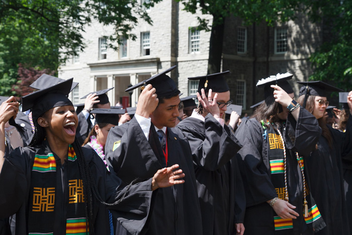 Members of the class of 2018 move their tassels from right to left, marking their transition from students to graduates. Photo by Carl Socolow '77.