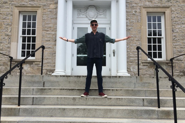 Taylor Hunkins '17 on the steps of The Trout Gallery, where he works as an education intern.