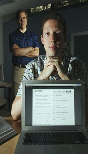 Asbury J. Clarke Professor of Classical Studies Christopher Francese and Nick Stender '15 pose behind a laptop displaying Stender's vocabulary lists for the