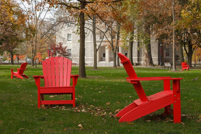 Red chairs on the lawn of the Dickinson campus.