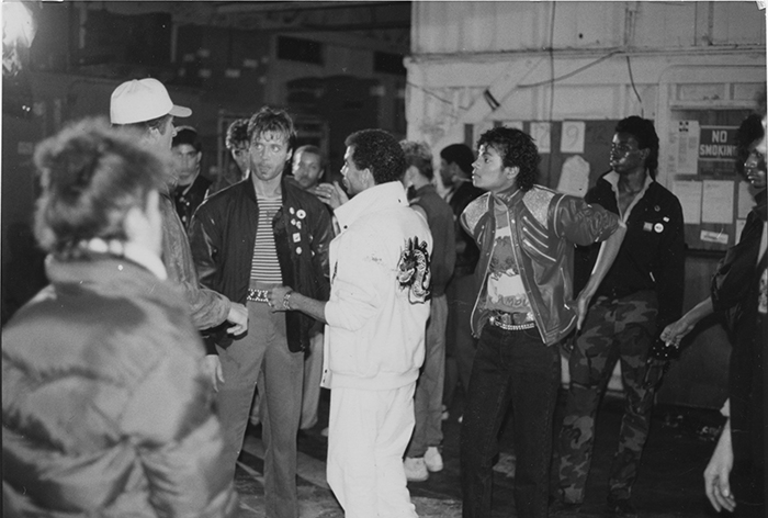 "Vincent Paterson (facing camera, first from left) and Michael Jackson (right) on the set of ""Beat It."""