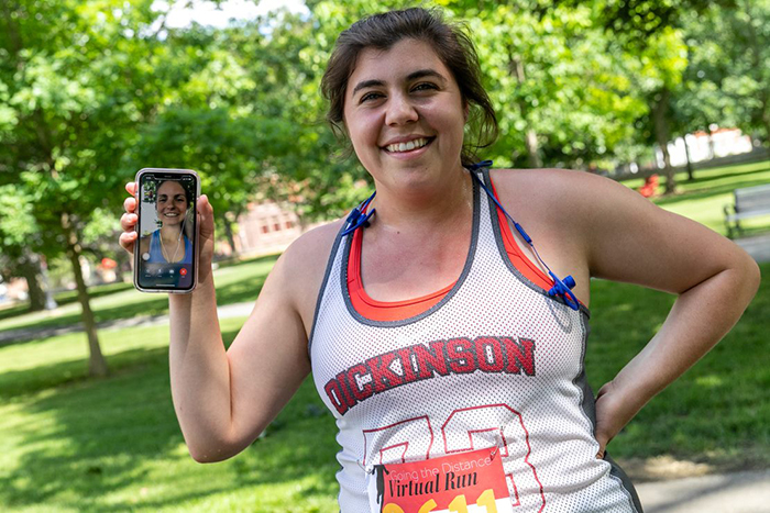 Olivia Termini '19 co-developed a virtual 5K with classmate Taylor Bednar (shown on Termini's phone screen). Photo by Carl Socolow '77.