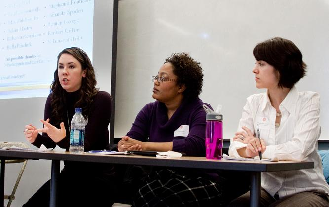 Female students participating in a panel discussion
