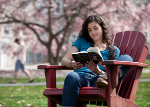 Student reading on campus